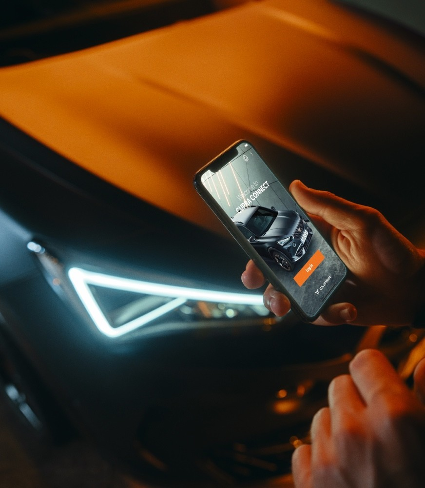 man-connected-to-cupra-connect-app-with-his-smartphone.jpg